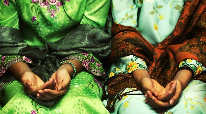 OCTOBER 6, 2011 Folded Hands, Brunei Photograph by Adam Hanif, Your Shot This Month in Photo of the Day: Photos From New National Geographic Books